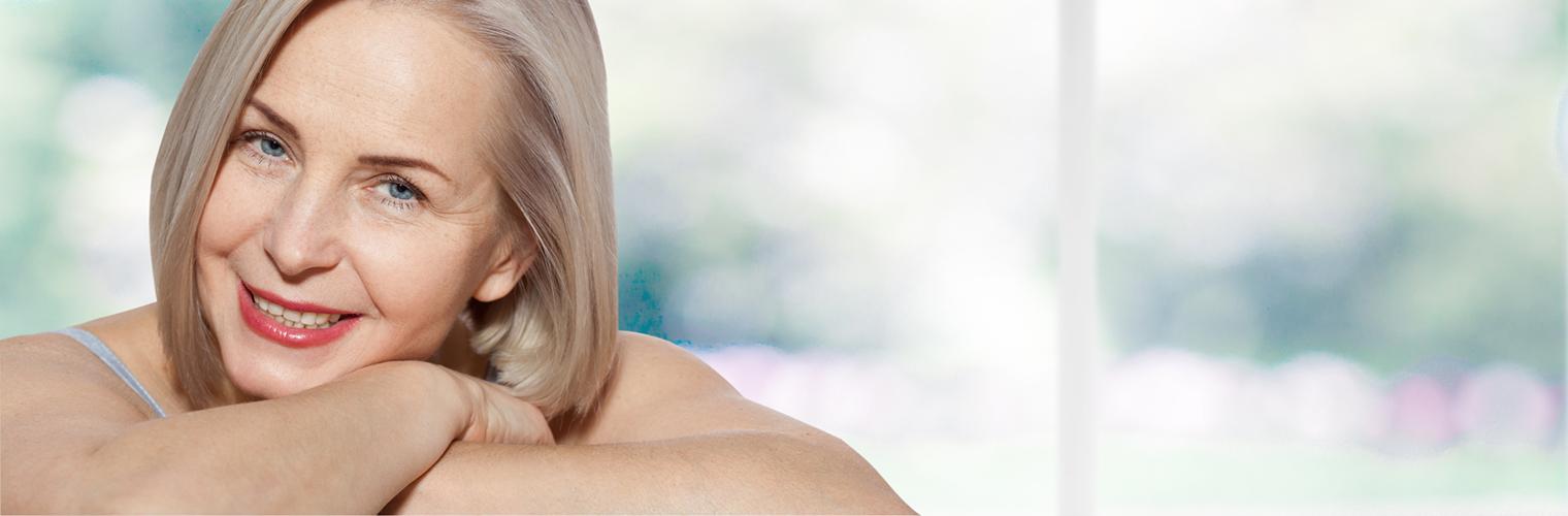 Beautiful middle aged woman fase close up.